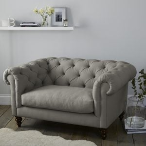 Grey cotton Chesterfield style snuggler armchair