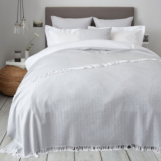 Herringbone white and grey cotton woven bedspread in contemporary bedroom