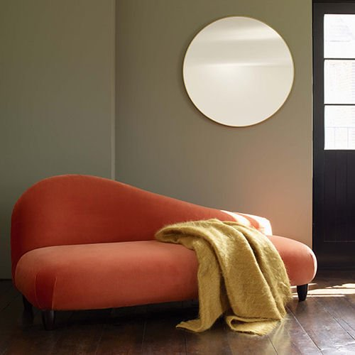 Habitat Isabel Velvet 2-Seater Sofa in orange with yellow throw and large round mirror