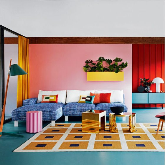 Colourful contemporary interior with millenial pink wall
