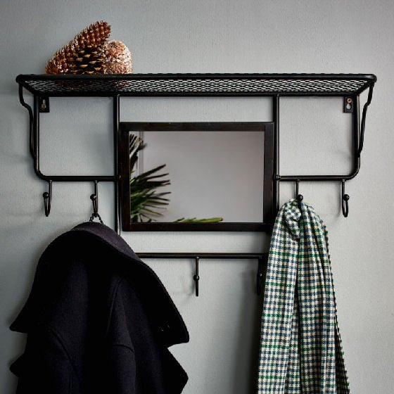 black industrial mirror with shelves and hooks