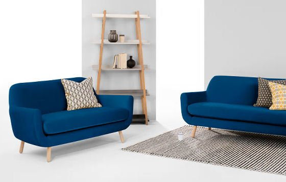 Blue velvet Jonah 2 Seater Sofa for small spaces with bookcase and cushions