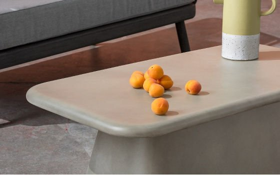 MADE Kalaw outdoor table in concrete - detail, with oranges and jug