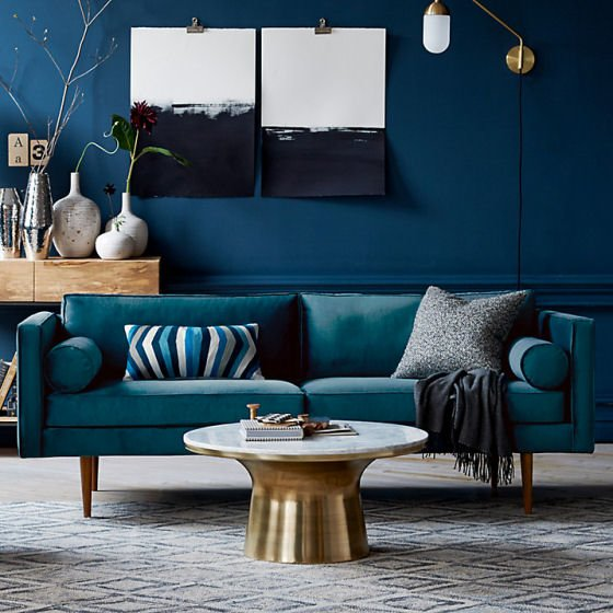 West Elm round Marble Pedestal Coffee Table in blue contemporary room setting