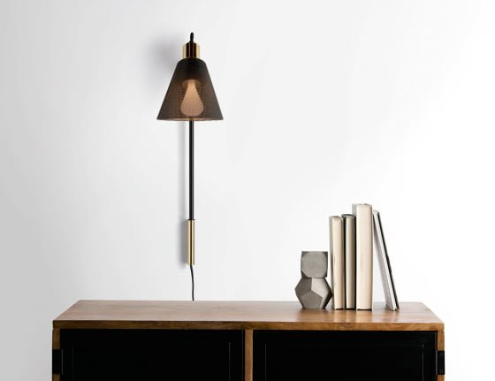 Black and brass wall light from Memoir Lighting Collection by Plumen x Made.com