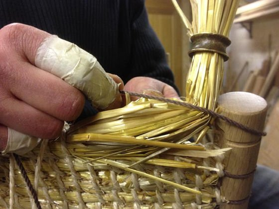 Kevin Gauld tying in the straw back of the Brodgar Chair, for the New Craftsmen project