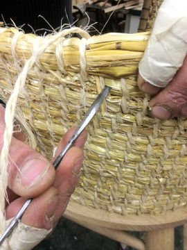 Kevin Gauld stitching the straw back of the Brodgar Chair