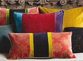 Colourful cushions by Oka Direct