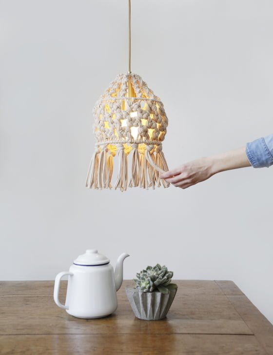 Ray Of Light DIY Macrame Lamp Shade hanging over wooden table with teapot and plant