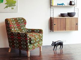 Contemporary furniture by SCP with armchair and shelving