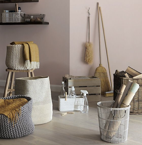 Croft Collection knitted storage baskets and white rattan baskets with other cleaning and utility items