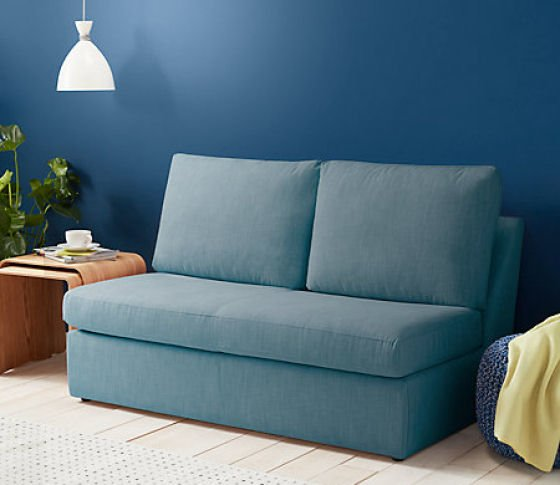 John Lewis Tilly Small Sofa Bed for small spaces in mid blue against a blue wall