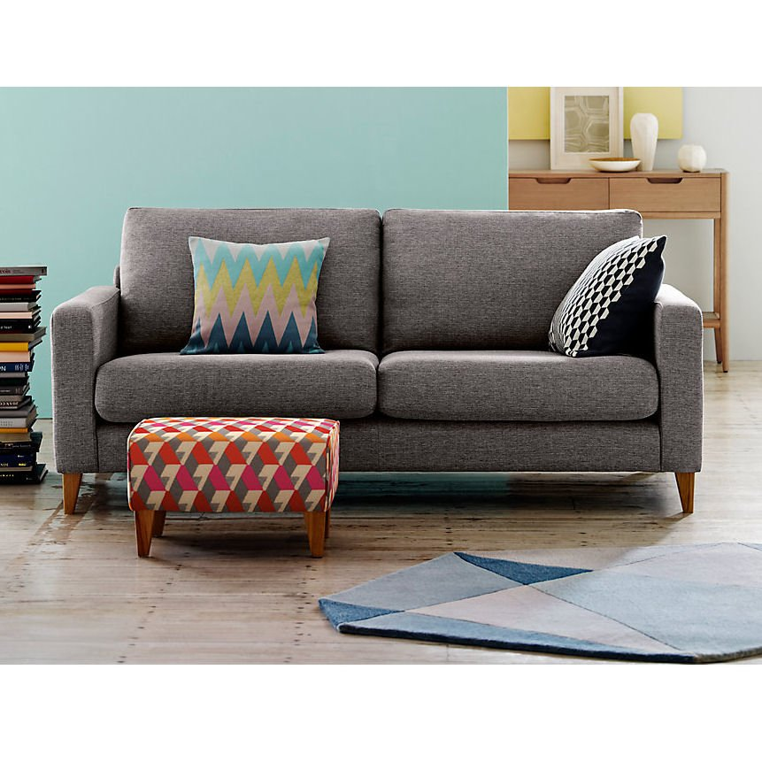 M&S Tromso compact grey fabric sofa with colourful cushions and footstool