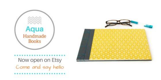Aqua Handmade Books Etsy logo and image of grey and yellow handmade journals