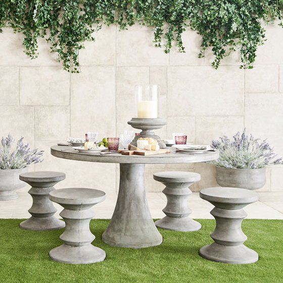 Oka Garden Furniture Sculptural petra outdoor furniture from oka direct colourful stone grey outdoor round dining table and stools in garden workwithnaturefo