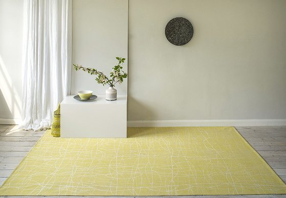 Helen Yardley yellow Chacha rug in modern room setting
