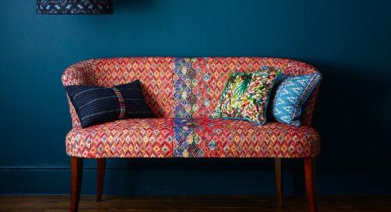 Ashbourne Sofa by A Rum Fellow against dark blue wall