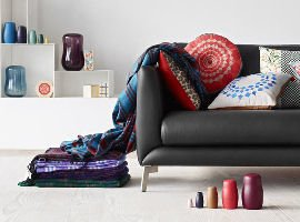 Boconcept grey sofa with colourful cushions and home accessories