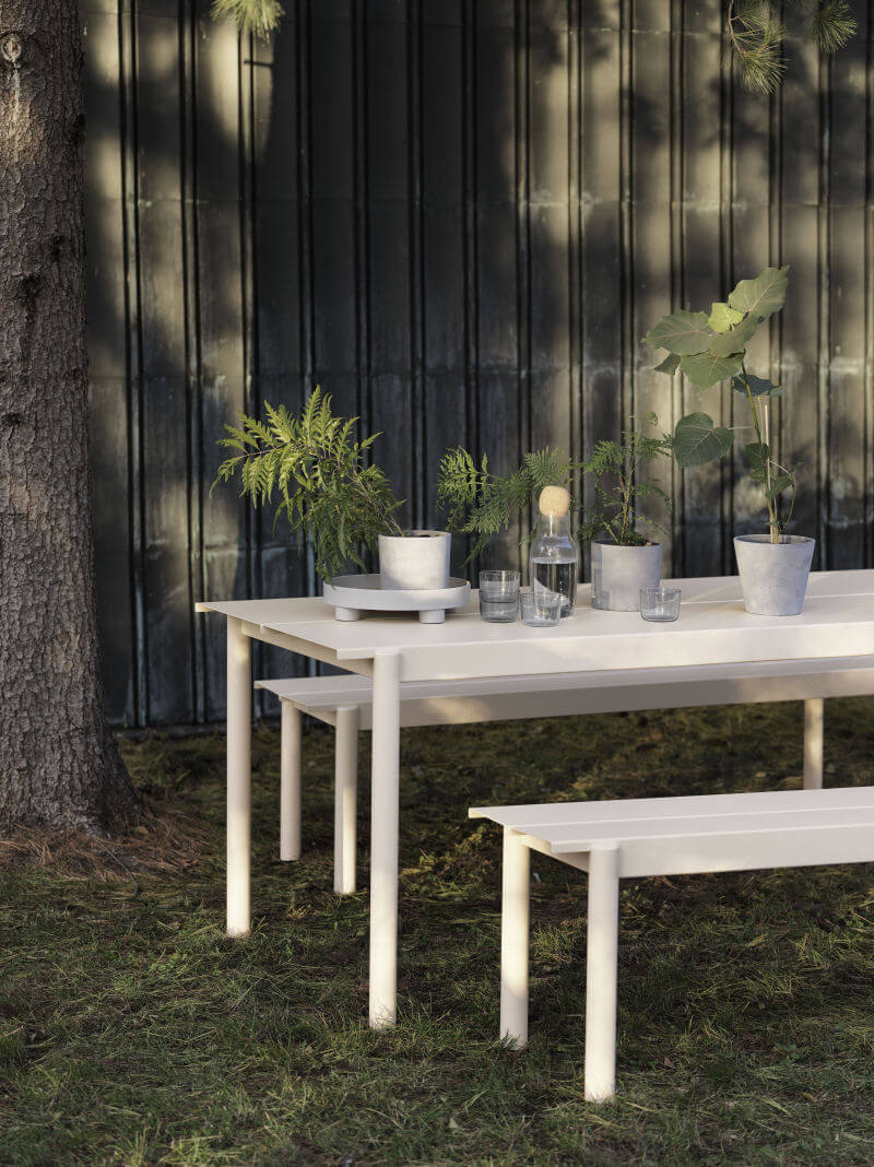 White Linear Outdoor Table and Benches in garden setting