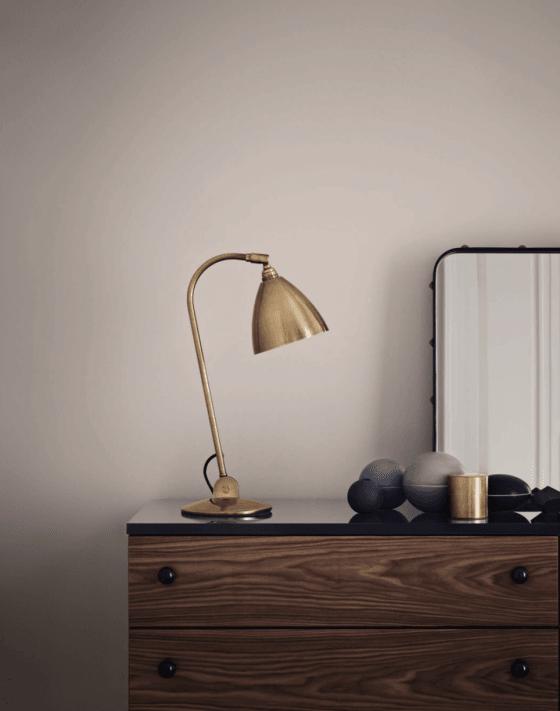 Contemporary Gubi Bestlite B2 brass desk or table lamp on wooden set of drawers