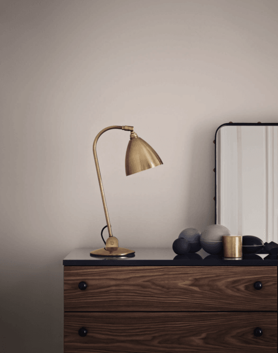 Contemporary Gubi Bestlite B2 brass desk or table lamp on wooden set of drawers
