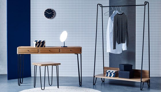 Heal's Brunel Console Table, Brunel Stool and Brunel Hanging Rail against blue geometric backdrop
