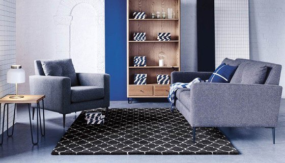 Heal's Brunel Sofa and Armchair in grey wool upholstery in living room setting