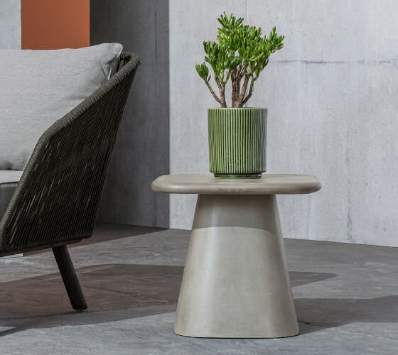 MADE Kalaw outdoor side table for contemporary outdoor room with plant in green pot