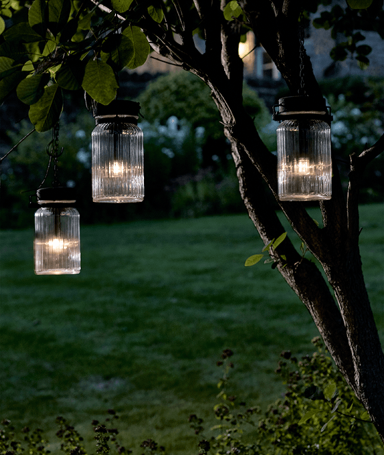 Cox and Cox outdoor Jar Lantern lights hanging from tree
