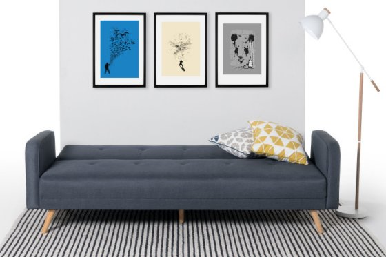 Chou Sofa Bed folded flat in room setting with cusshion, pictures and lamp