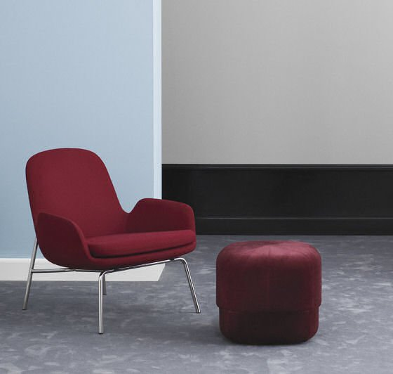 Normann Copenhagen Circus Velour Pouf in red velvet with red chair against blue wall