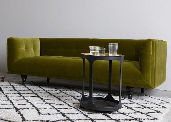contemporary velvet sofa in olive green cotton velvet with black side table