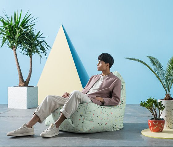 Ayra Bean Chair in outdoor fabric with terrazzo print in outdoor room setting