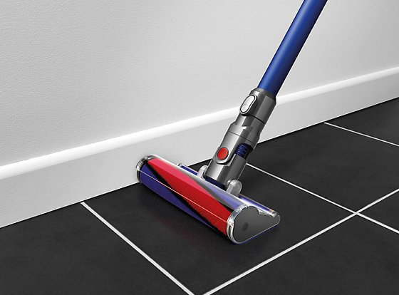 Dyson V6 Fluffy Cordless Vacuum Cleaner on black tiled floor