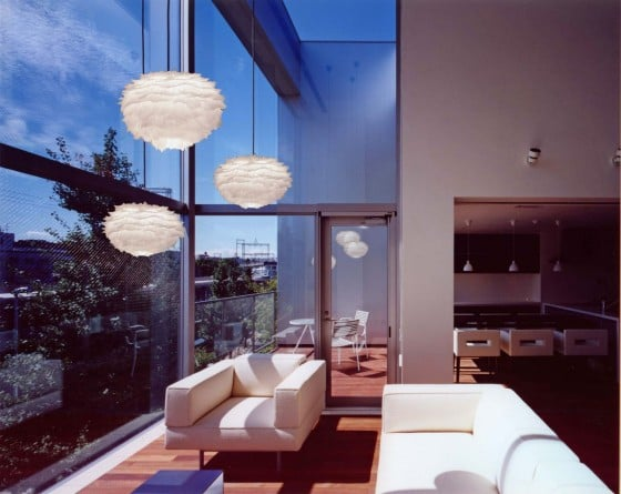 3 VITA Eos pendant lights hung in the window of a contemporary room