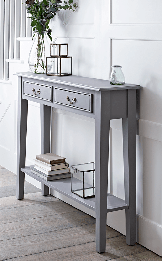 Narrow grey console table with drawers and shelf by Cox and Cox
