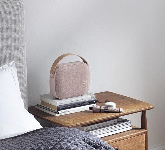 Vifa Helsinki Bluetooth Speaker in blush pink on bedside table