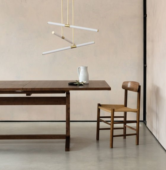 Hutton modern ceiling LED pendant light in brass and white over dining table