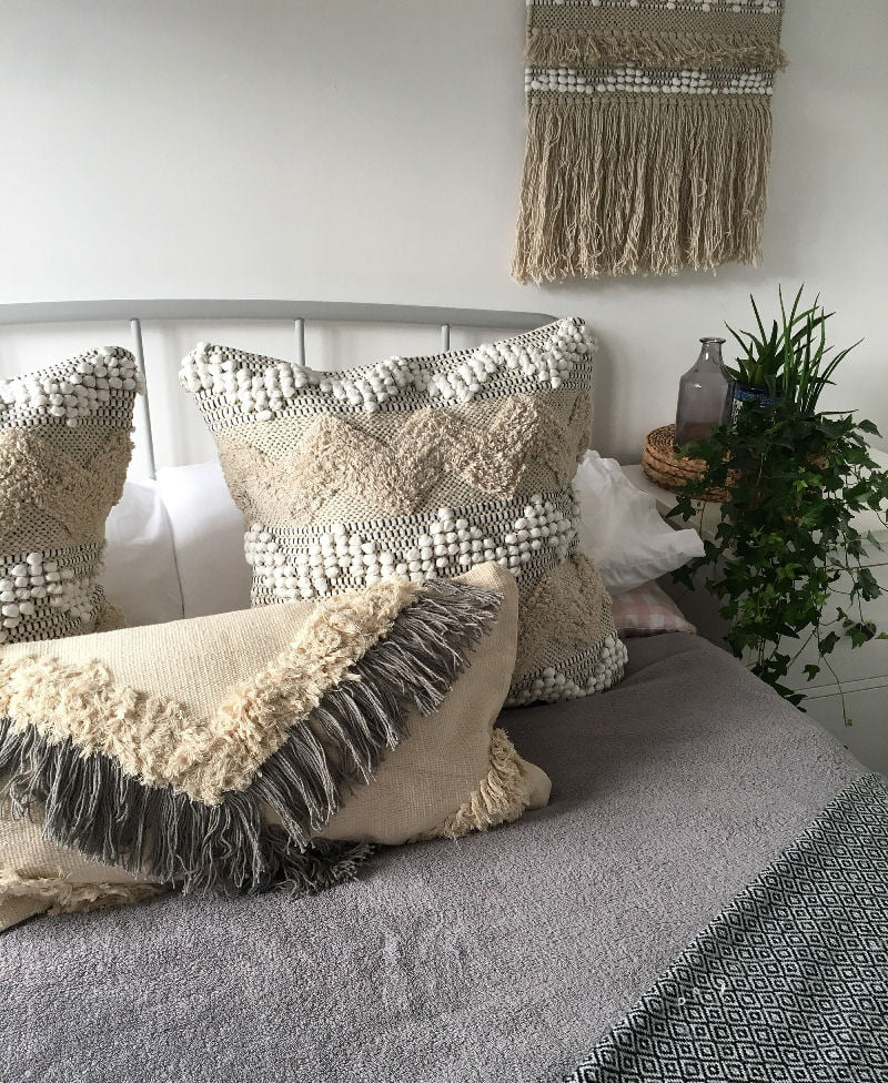 Neutral boho tasselled cushions from Etsy shop A House A Home