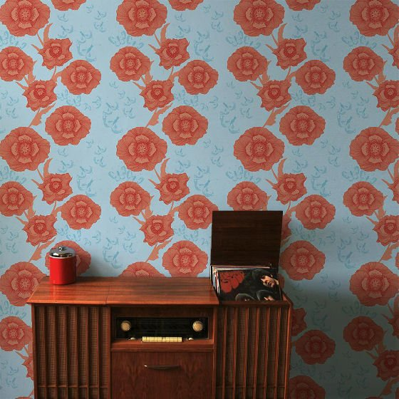 Camilla Meijer modern floral wallpaper in blue and orange with retro furniture
