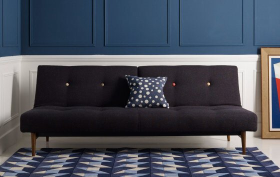 Heal's Knap Sofa Bed with blue and white walls and geometric rug and dot cushion