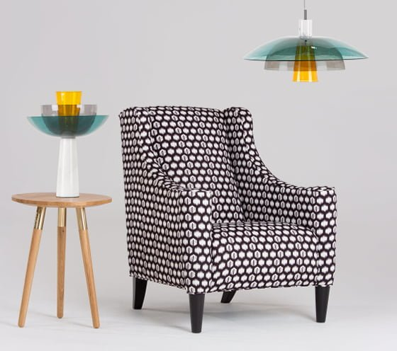 MADE.com coloured glass pendant light and table lamp with armchair and wooden side table