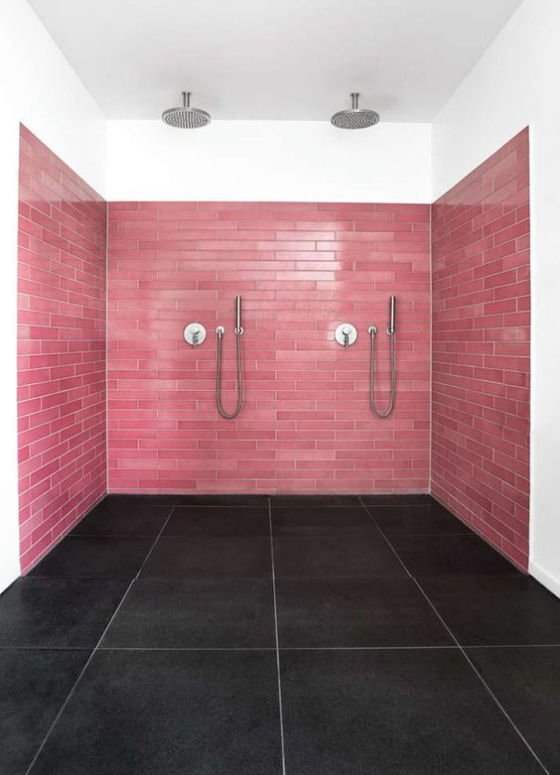 Double shower with pink lavastone tiled walls and grey lavastone tile floor by Made a Mano