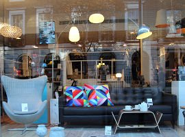 Aria contemporary design shop window with mid century furniture