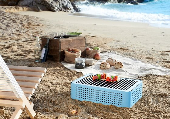 RS Barcelona Mon Oncle portable barbecue in blue on beach with food and chair