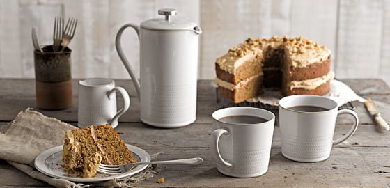 Denby Natural Canvas cafetiere, small jug and coffee cups with coffee and walnut cake