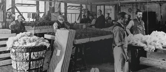 Old black and white photo of Heal's mattresses being made