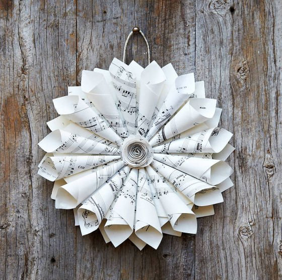 flower shaped wreath made from vintage sheet music paper