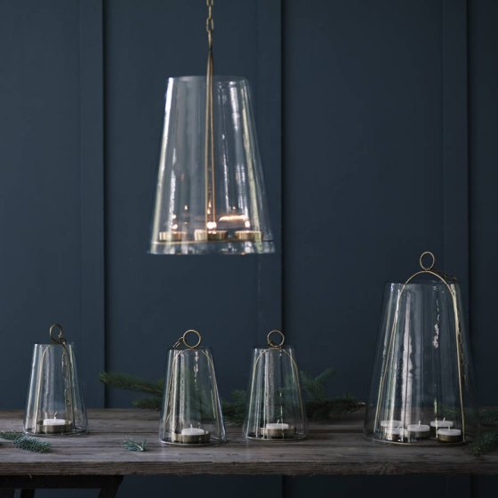 Outdoor lighting ideas: contemporary hanging glass lanterns with brass fittings