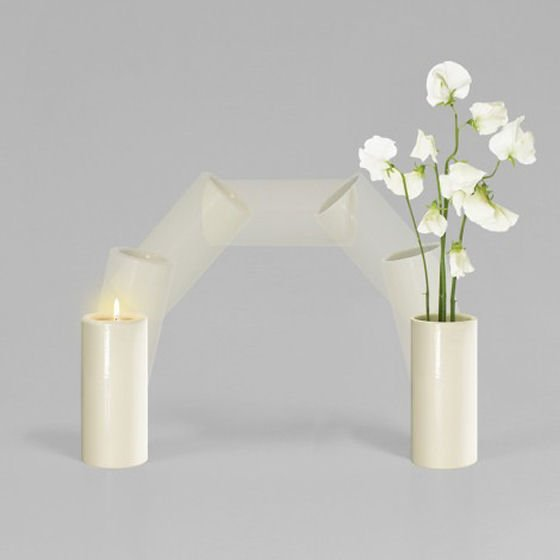 Trioglo candle holder that turns upside down to become a vase